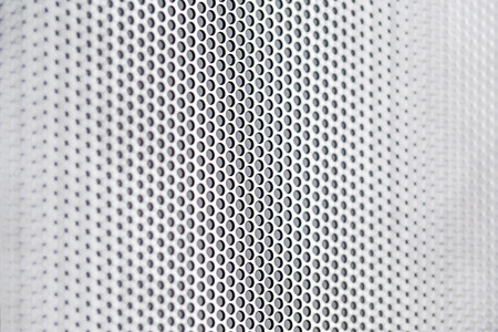 holed: Chrome metal holed or perforated grid background Stock Photo