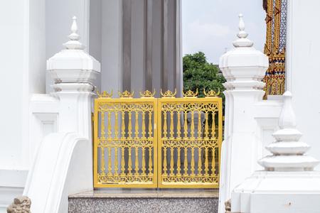 The church door temple at Wat Intharawihan in Bangkok, Thailand. photo