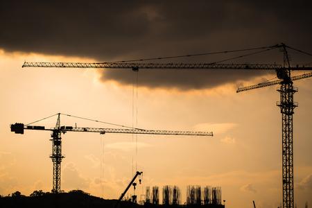 industrial landscape: Industrial landscape with silhouettes of cranes