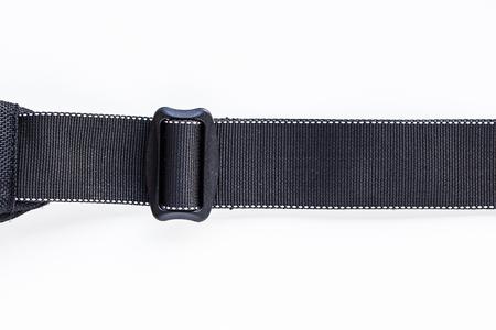 Black belt rope strap lanyard, hanging metal clasp snap latch hook carabiner, isolated macro closeup latch Stockfoto