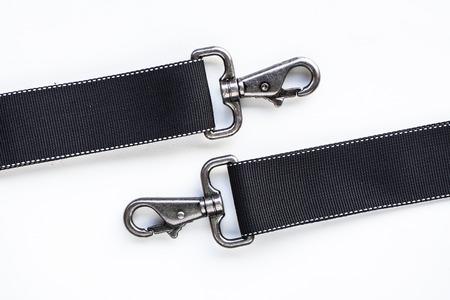latch: Black belt rope strap lanyard, hanging metal clasp snap latch hook carabiner, isolated macro closeup latch Stock Photo