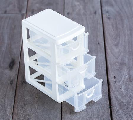 mini storage plastic box for office on wood background Stockfoto