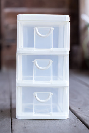 stackable: mini storage plastic box for office on wood background Stock Photo