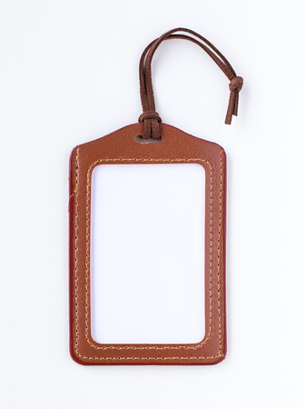 blank tag: Brown leather label tag with string, isolated on the white Stock Photo