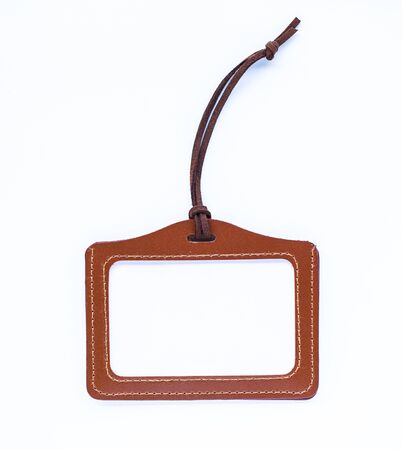 Brown leather label tag with string isolated on the white