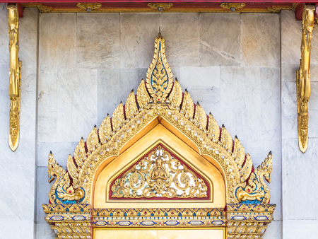 The architecture of the window thai stucco thai paint on windows at wat or temple at Wat Benjamabophit in Bangkok Thailand. photo