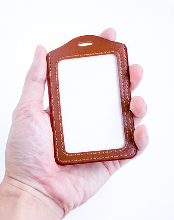 leather label: Brown leather label tag with string isolated on the white background.