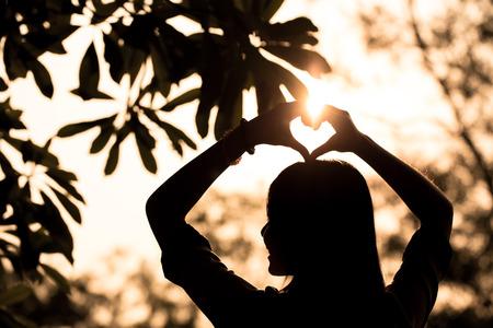 Love shape hand silhouette in sky Stockfoto