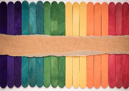 colorful wooden wall texture with Torn paper background empty for add text photo
