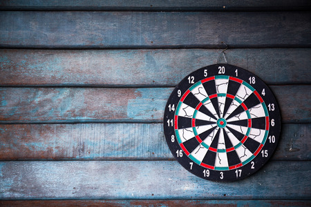 The darts isolated on wooden background Stockfoto