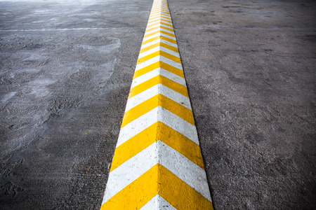 path ways: A yellow stripe speed ramp on concrete road. Stock Photo