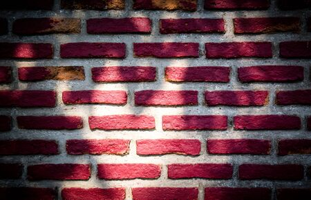 historica: shadow sun light on red brick wall for texture or background