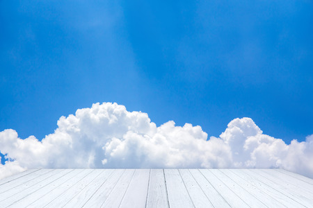 add text: Blue sky and clouds with white wooden floor and space for add text above