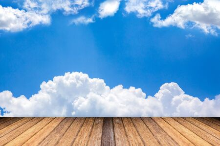 add text: Blue sky and clouds with brown wooden floor and space for add text above Stock Photo