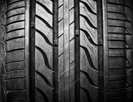 Car tires close-up on black background Stockfoto