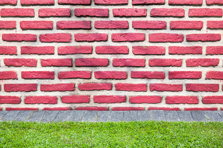 historica: red brick wall for texture or background with grass ground
