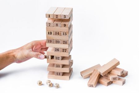 play blocks: hand man play blocks wood, tower wooden game on white background. Stock Photo