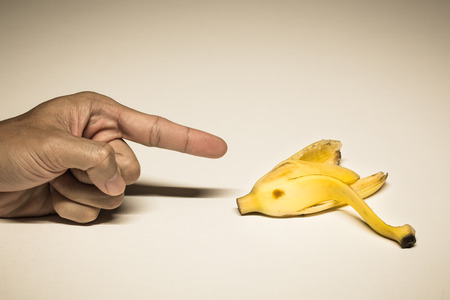 banana skin: empty banana skin, abstract banana peel with forefinger