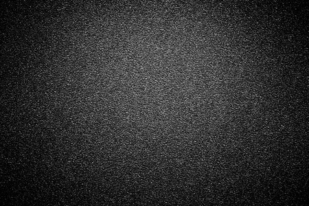 black sandpaper texture background.