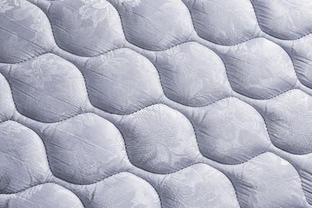 cama: colchón blanco Patrón de ropa de cama de fondo Foto de archivo