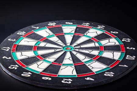 bull     s eye: Dart board is the target and goal. Success hitting target aim goal achievement.
