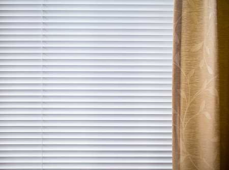 blinds: Metal Blinds with drawstring. Roller Shutter Background with curtain.