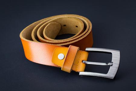 suede belt: brown leather belt for men on black background