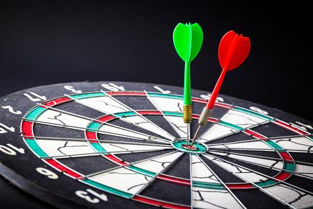 bull     s eye: Dart board is the target and goal.