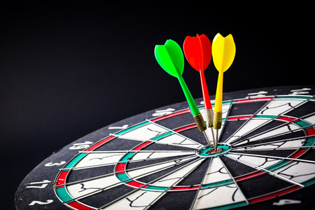 bull     s eye: Dart board is the target and goal. Success hitting target aim goal achievement. financial concept with goal money.