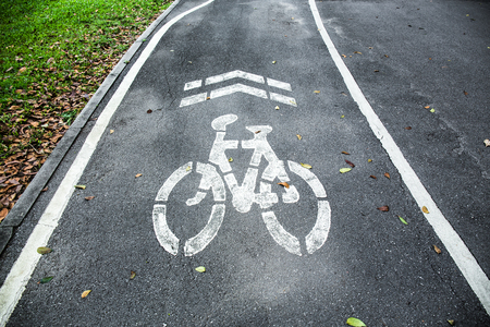 Sign of bike lane in the park.