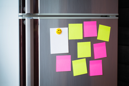 Abstract Empty paper sheet with magnet on refrigerator door. paper note background