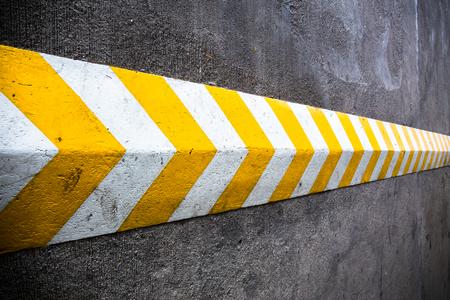 A yellow stripe speed ramp on concrete road. Stockfoto