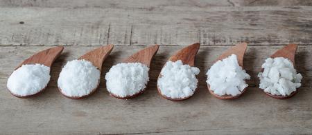 Sea salt on wooden table. spa salt
