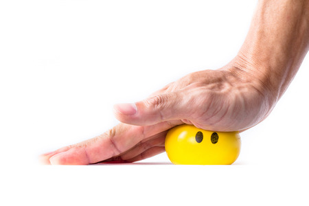 man elderly practicing holding, grabbing, pressing, and squeezing a soft ball as a way for treatment of Trigger finger, Digital flexor tenosynovitis