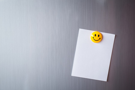 note: Abstract of Blank paper and post-it on refrigerator door. Stock Photo