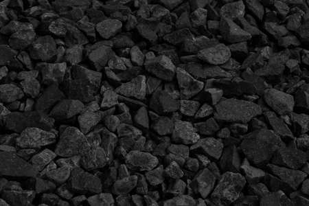 Natural black coals for background design. Industrial coals. Volcanic rock energy on earth. Фото со стока