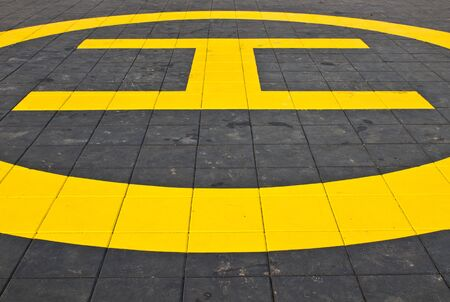 helicopter pad: The yellow helipad