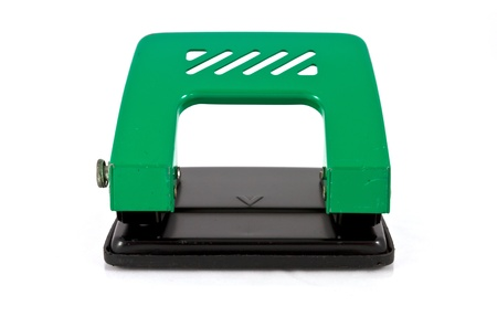 Green paper hole puncher on white background photo