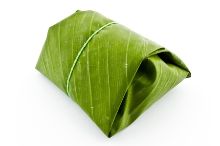 thai dessert: Sticky rice wrapped in banana leaf Stock Photo