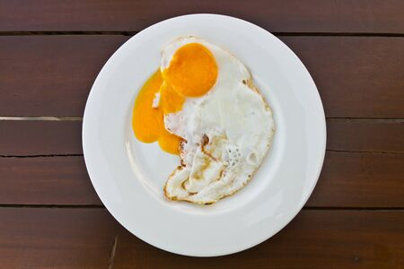 sunny side up: Fired egg on wood table