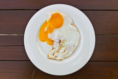 fired egg: Fired egg on wood table