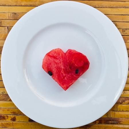 Heart shape watermelon on white plate