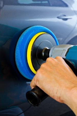 Hand holding car polisher Stock Photo