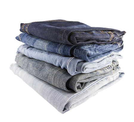 Stack of jeans on white background photo