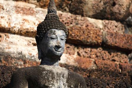 An ancient Buddha image at Sukhothai historical park, Thailand Stock Photo - 15974542
