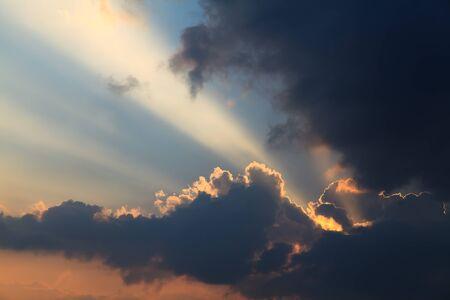 shining through: Ray of light shining through the dark cloud