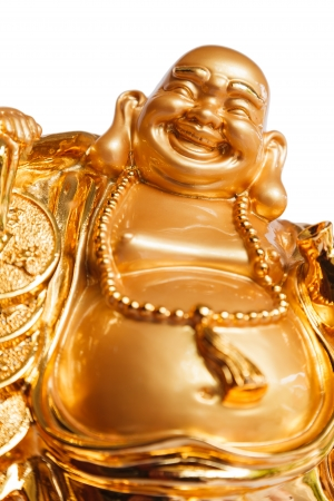Smiling Buddha - Chinese God of Happiness, Wealth and Lucky Isolated on white background photo