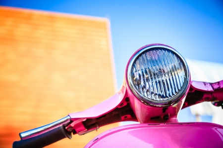 Close-up pink retro motorcycle with colorful background Stock Photo