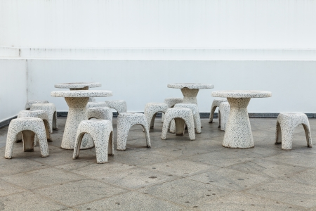 Group of stone tables and stools on the floor