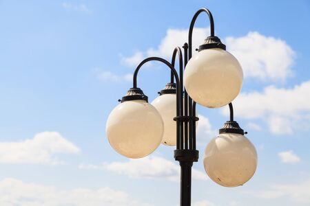 Sphere street lamps with blue sky background photo